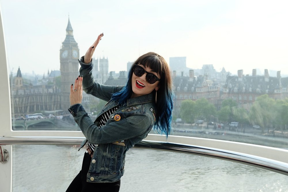 Here's Jenna holding up the Louvre.