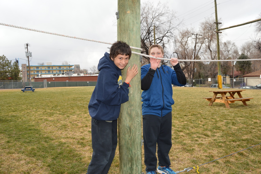 Trained facilitators help kids tackle the ropes course where they learn teamwork and communication skills.