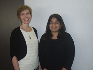 Shilpa Samant (right) receives the Sea Star International Food Safety Outreach and Education Poster Award from Jessica Shabatura, Sea Star president.