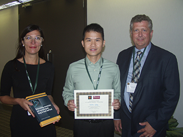 Hou Min Zhong (center) receives the 3-D Corporate Solutions Pet Food and Animal Feed Safety Poster Award (Second Place). With him are Patricia Osborn (left) of Elsevier and Hank Cotney (right) of 3-D Corporate Solutions.