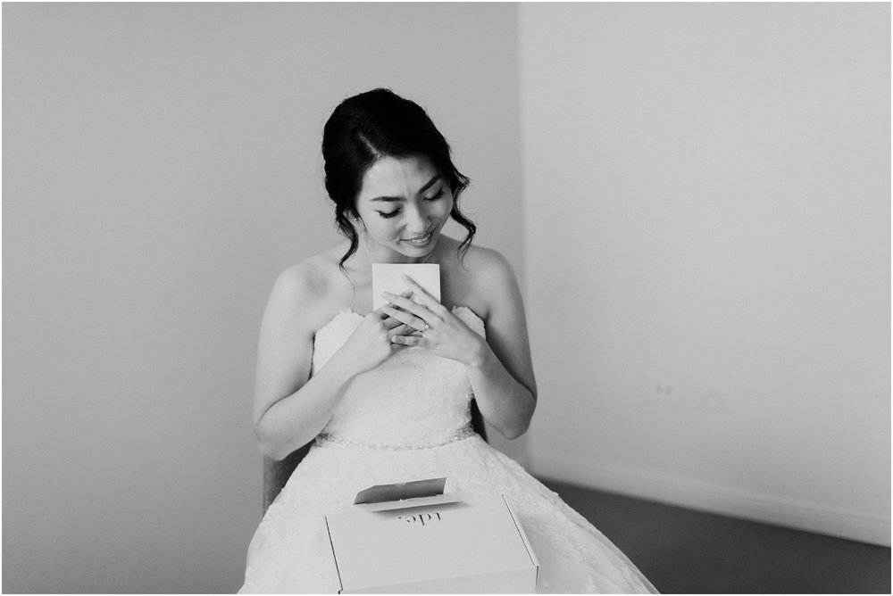 Candid bride prep photo