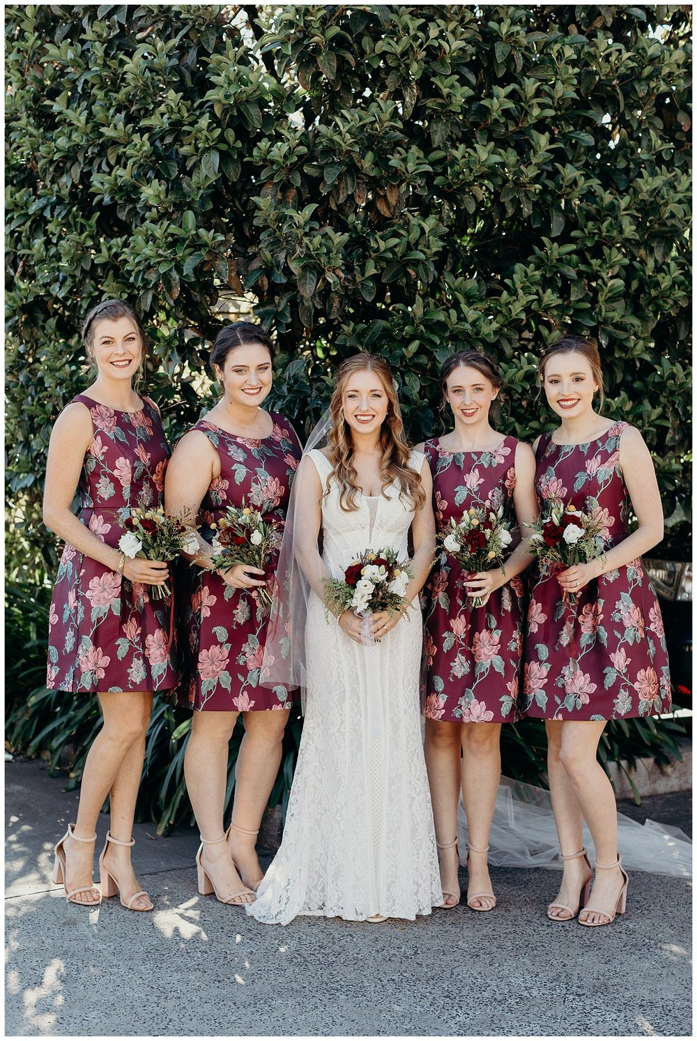 Bowral Southern Highlands Autumn Wedding - Bride and bridesmaids in floral maroon dress