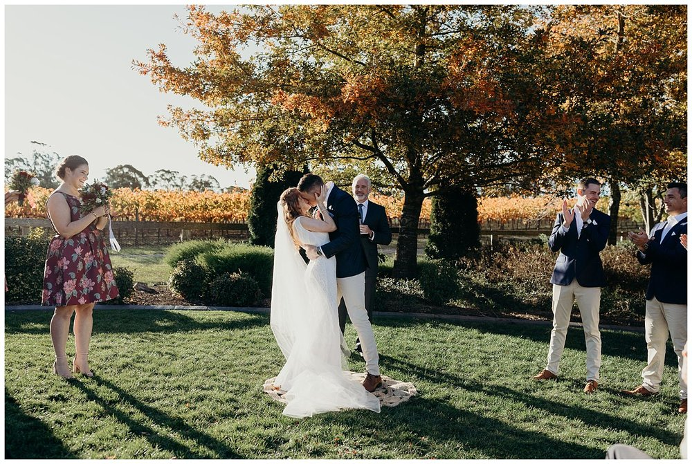 Bowral Southern Highlands Autumn Wedding - Centennial Vineyards first kiss on lawn