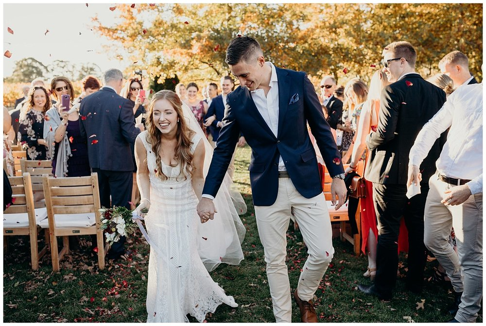Bowral Southern Highlands Autumn Wedding - Bride and groom showered in confetti