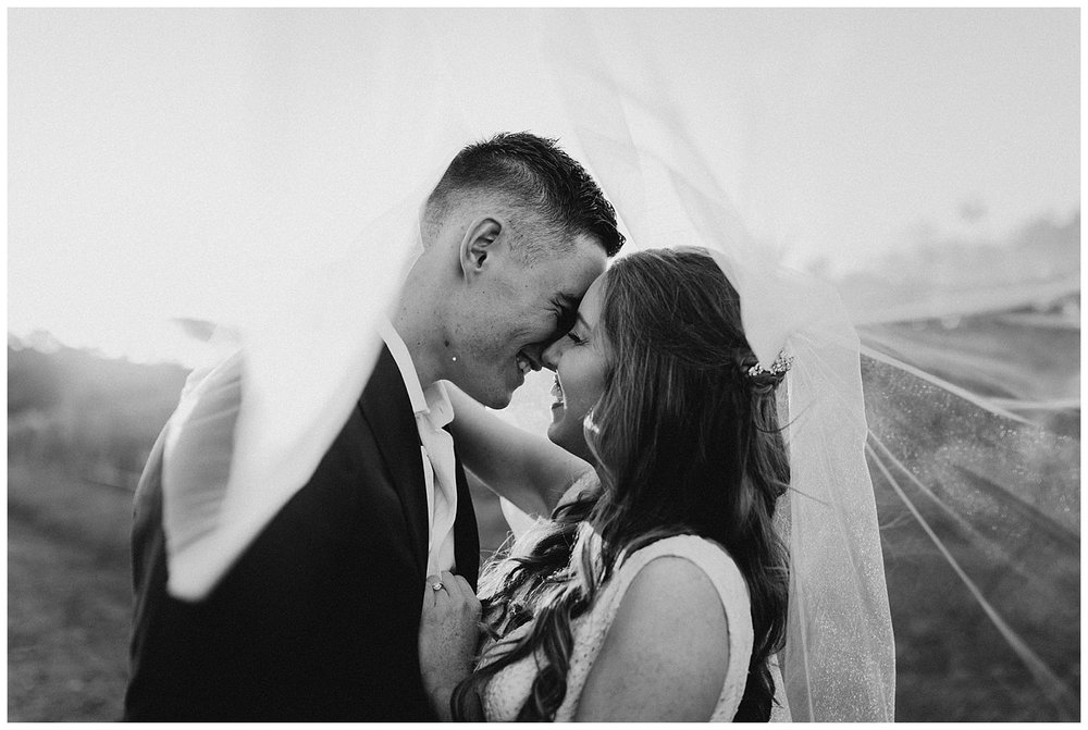 Bowral Southern Highlands Autumn Wedding - black and white sunset portrait through veil