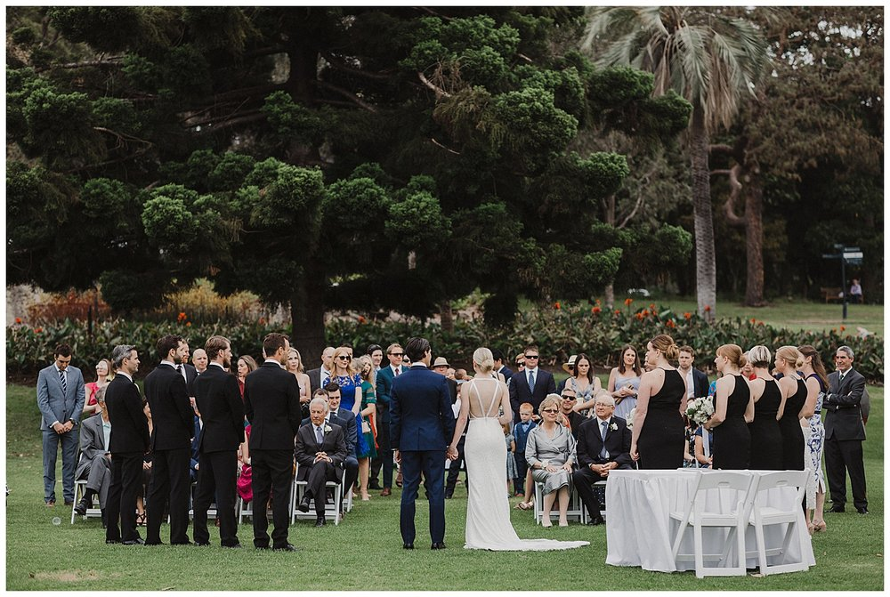 Bridal Party looks towards guests at a Sydney Wedding in the Royal Botanic Gardens