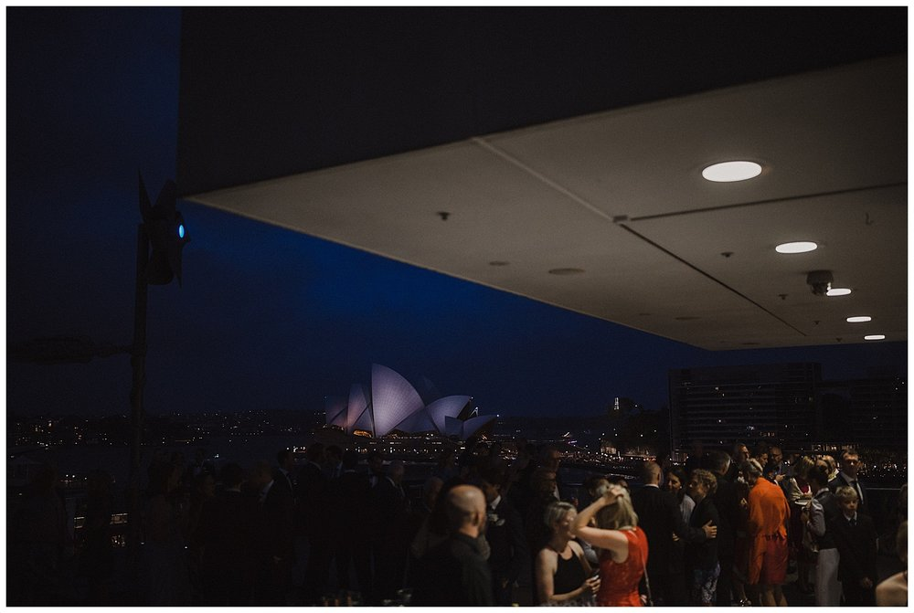 Iconic views of the Sydney Opera House from the MCA terrace during couple's wedding reception.