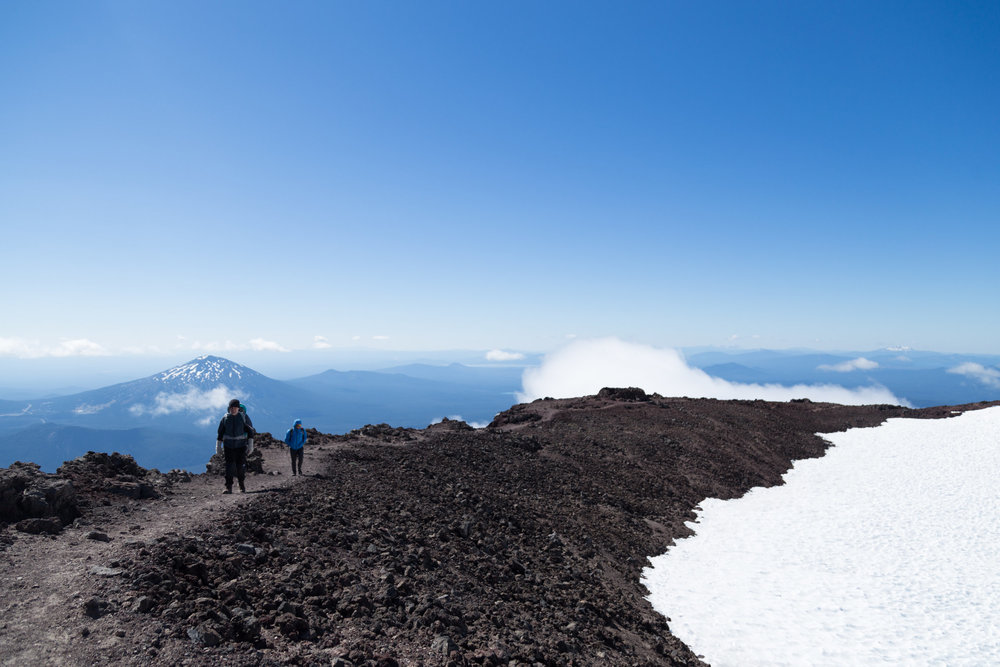 Following the rocky ridge that hems the glacier on top of South Sister. In summer, this glacier melts to become Oregon's highest lake, Teardrop Pool.