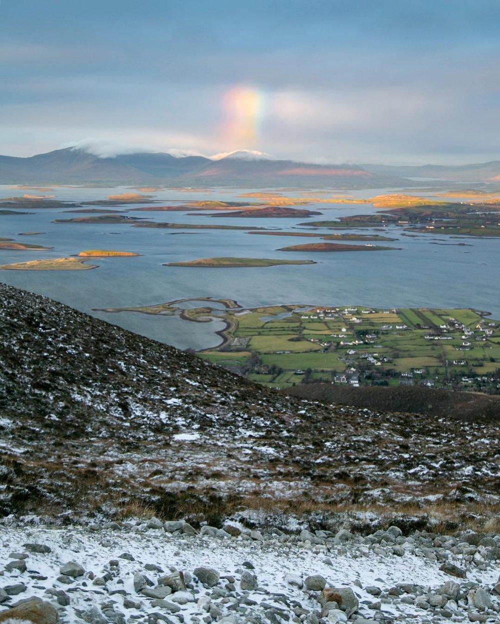 Beautiful Irish countryside under a rainbow