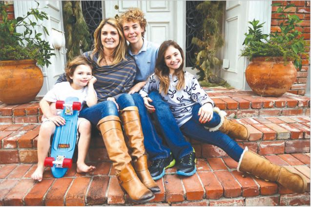 Lara Smith with her children Charlie, Henry, and Annie.