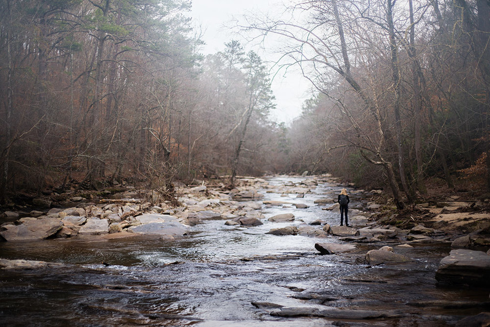 Woman-standing-in-river-in-fall-Sope-Creek-by-Atlanta-photographer-Chanel-French-1