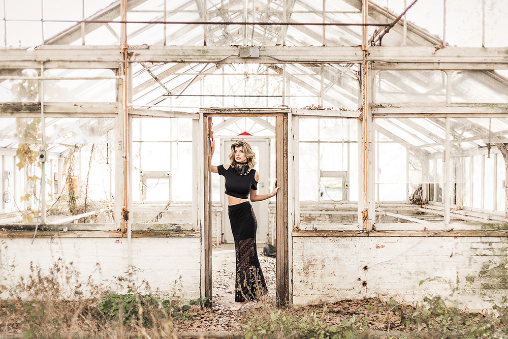 Model-in-black-lace-skirt-and-crop-top-in-abandoned-greenhouse-by-Atlanta-photographer-Chanel-French.jpg