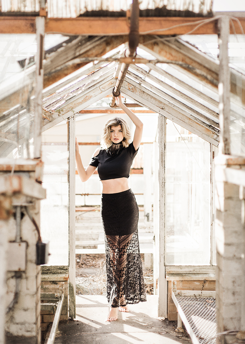 Abandoned-greenhouse-model-Jenna-Schulz-wearing-black-lace-skirt-and-crop-top-by-Atlanta-photographer-Chanel-French.jpg