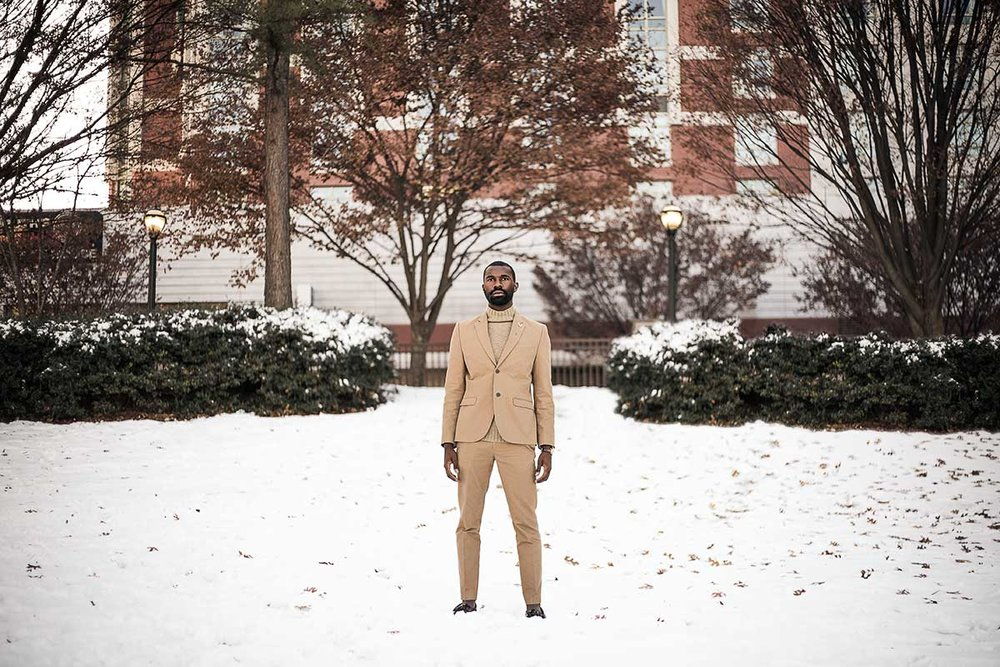 Atlanta-male-model-in-snow-in-tan-suit-at-Centennial-Olympic-Park-by-photographer-Chanel-French