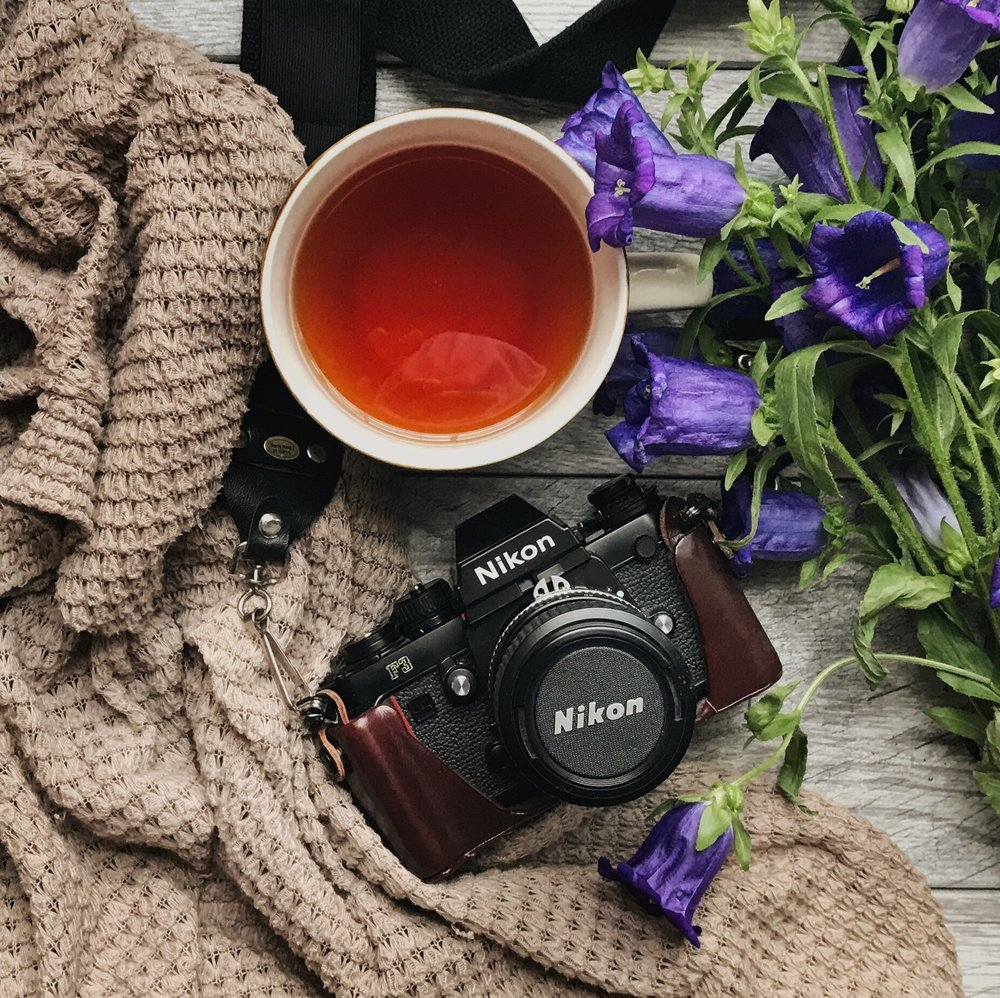 Nikin-film-camera-with-purple-flowers-and-cup-of-tea