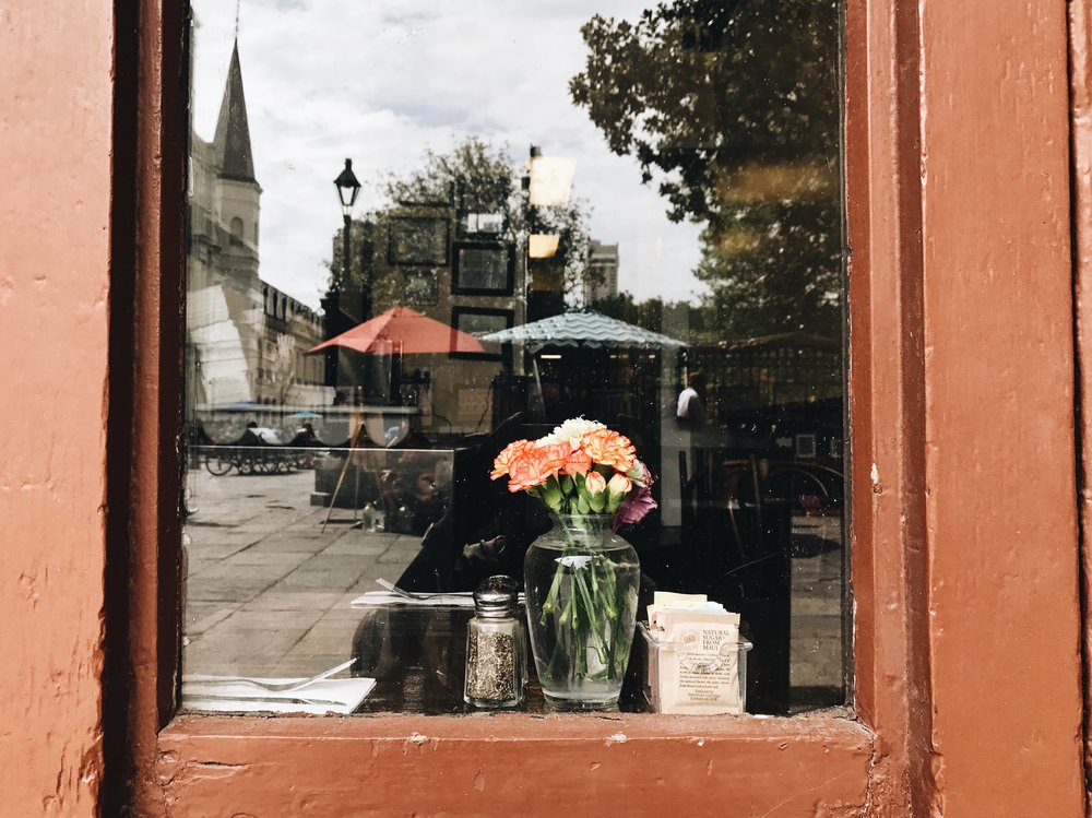 New-Orleans-street-photography-by-Atlanta-photographer-Chanel-French-flowers-in-cafe-window-French-quarter.jpg