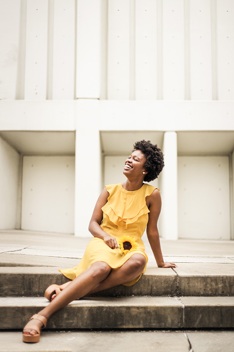 Yellow-dress-from-dressup-black-woman-with-afro-in-city-with-sunflower-Atlanta-photography-workshop-by-photographer-Chanel-French