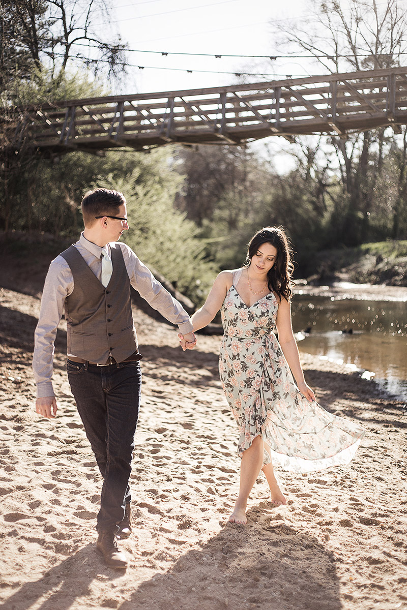 Couple-engagement-session-poses-with-floral-dress-at-Morningside-Nature-Preserve-by-Atlanta-photographer-Chanel-French.jpg