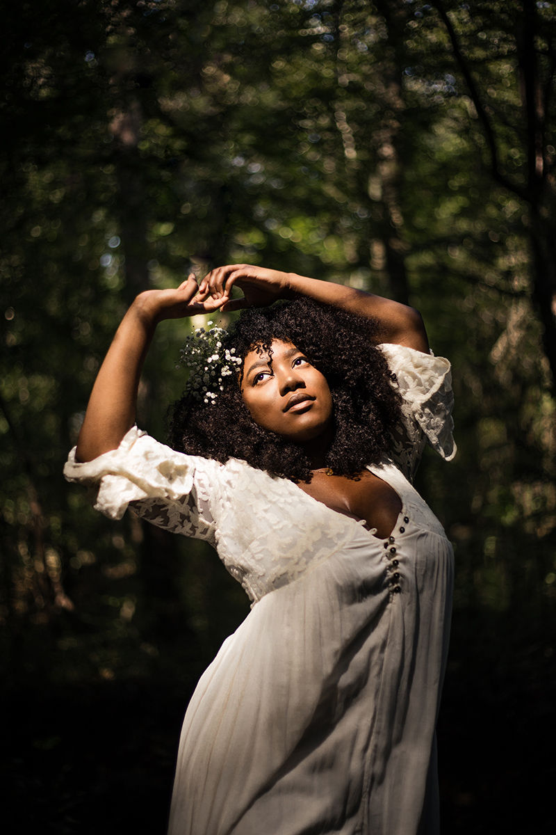 Black-woman-with-natural-curly-hair-dancing-in-sun-by-Atlanta-portrait-photographer-Chanel-French