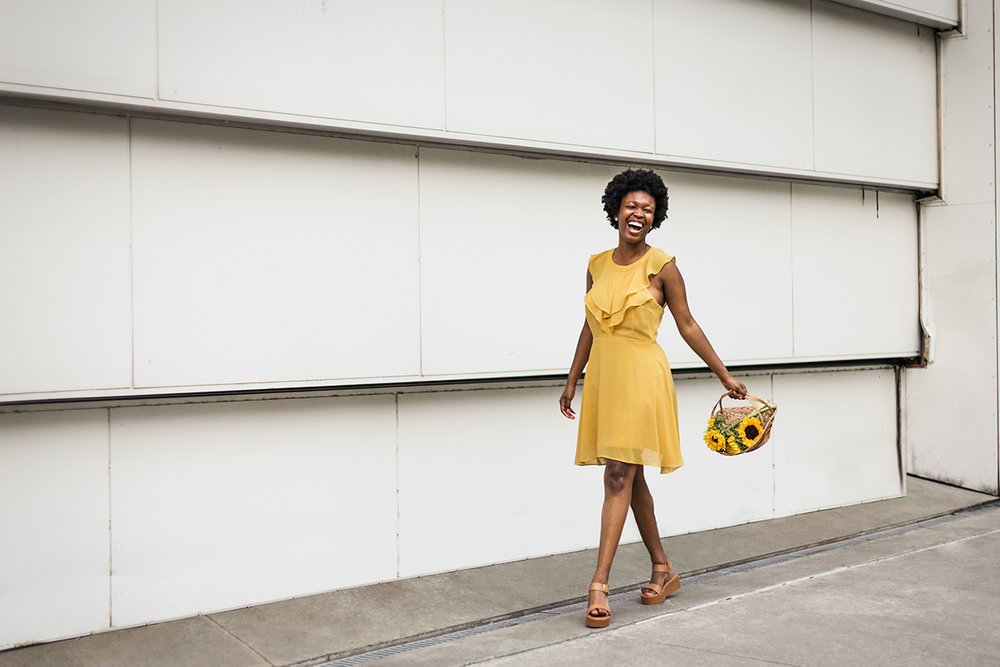 Black-woman-with-fro-in-yellow-dress-from-Dressup-with-sunflowers-in-basket-by-Atlanta-photographer-Chanel-French.jpg