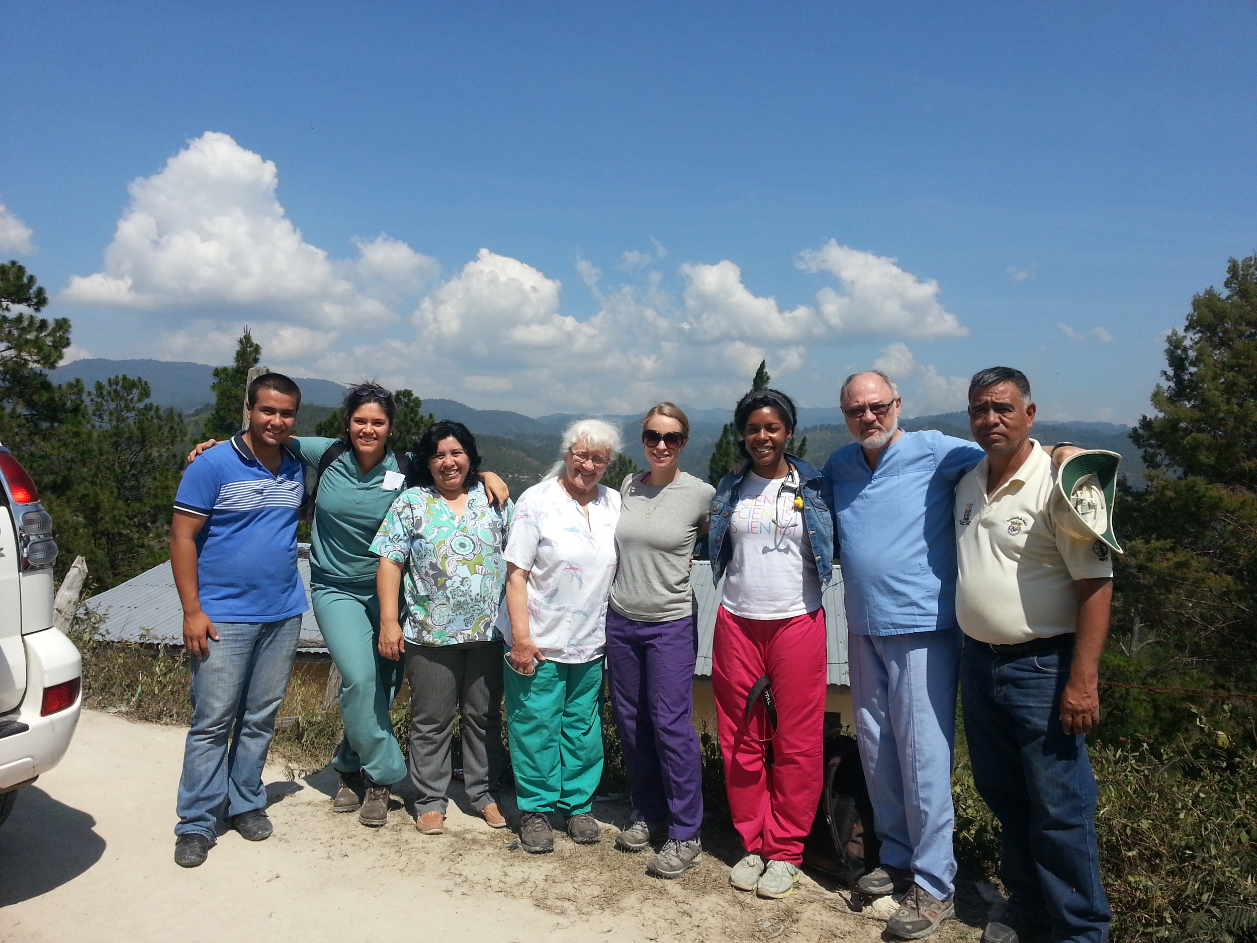 Group picture in front of the school. L-R Wilmer(Dr. Mabel's son who helped us translate), Alisha, Dr. Mabel, Esther, Danielle, Mallory, Dr. Gorodzinsky and Joaquim (our amazing driver)