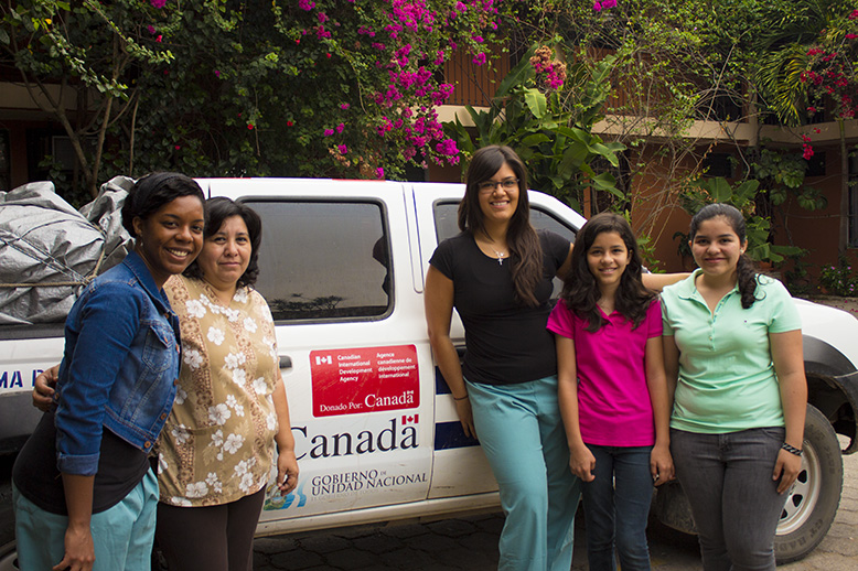 In front of our truck. L-R Mallory, Dr. Mabel, Alisha, Cheryl and Laura (our amazing translators)