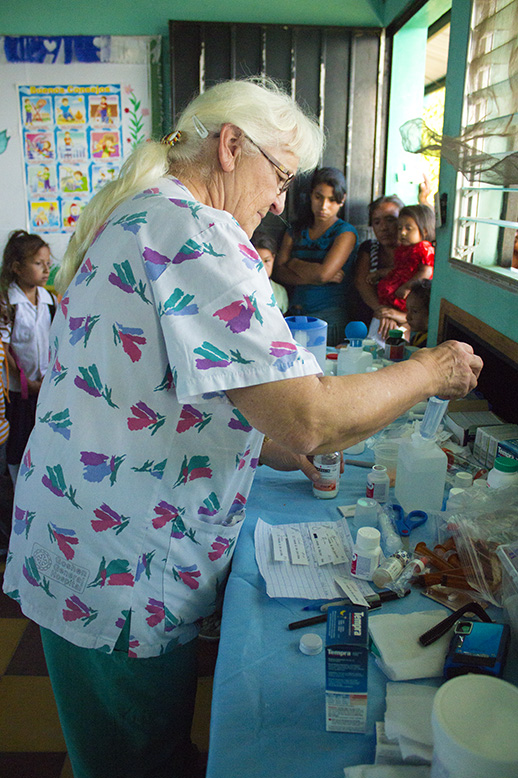 Esther Kern preparing medications for our little patients.