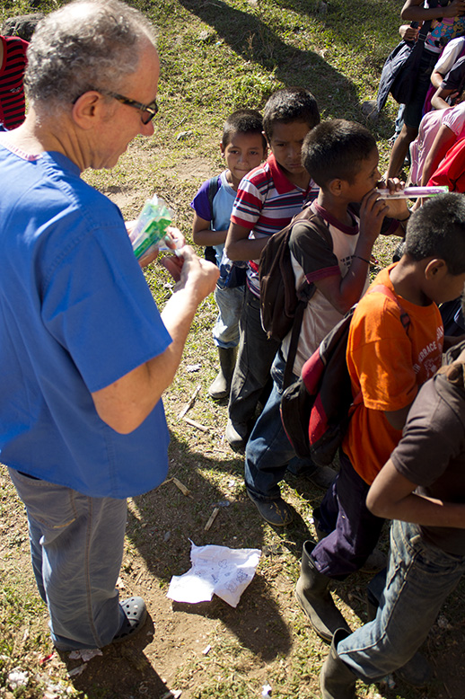 Dr. Freidman was handing out toothbrush and explaining to children how to brush their teeth
