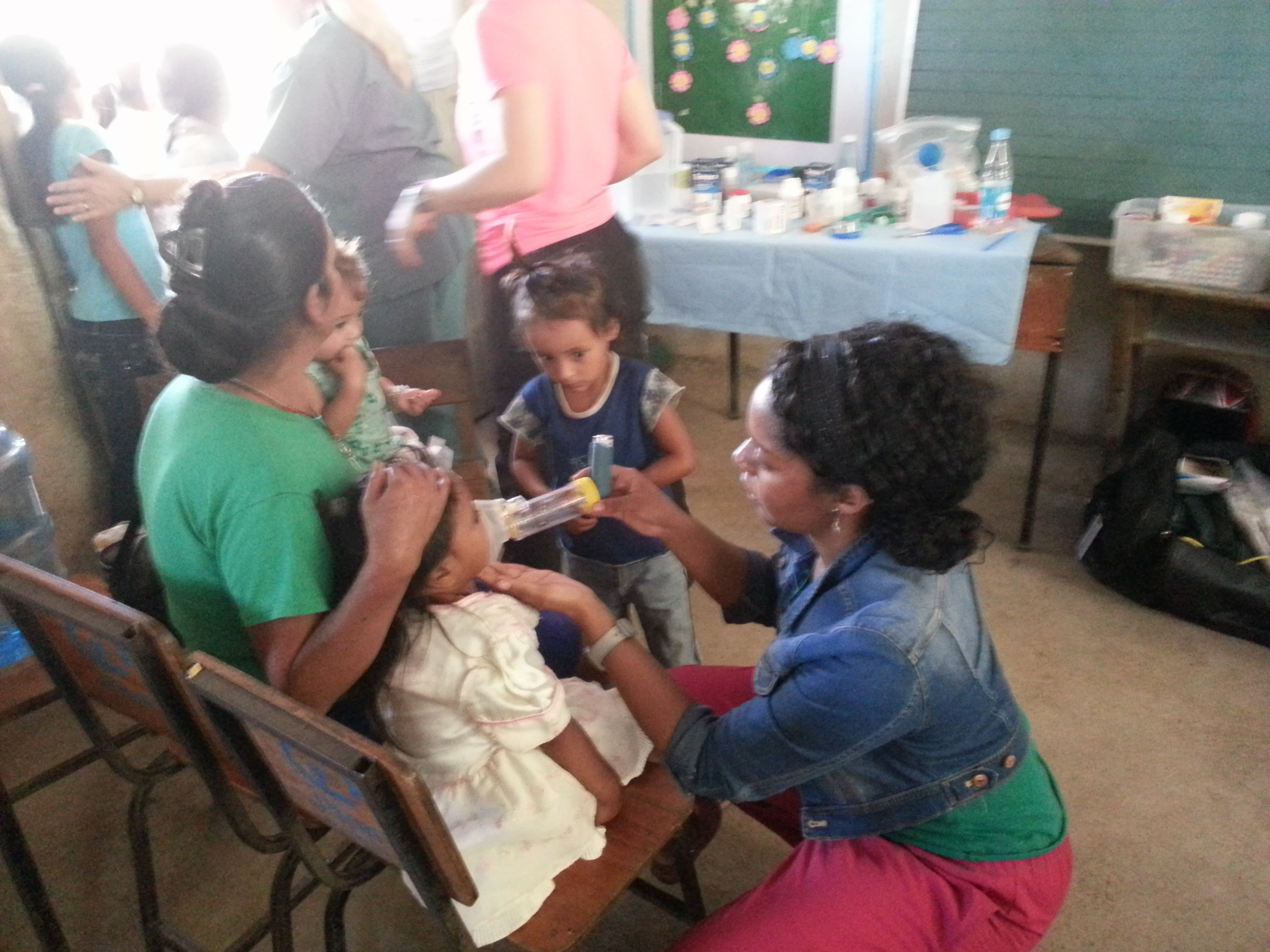 Dr. Chavannes giving a child treatment to help her breathe better