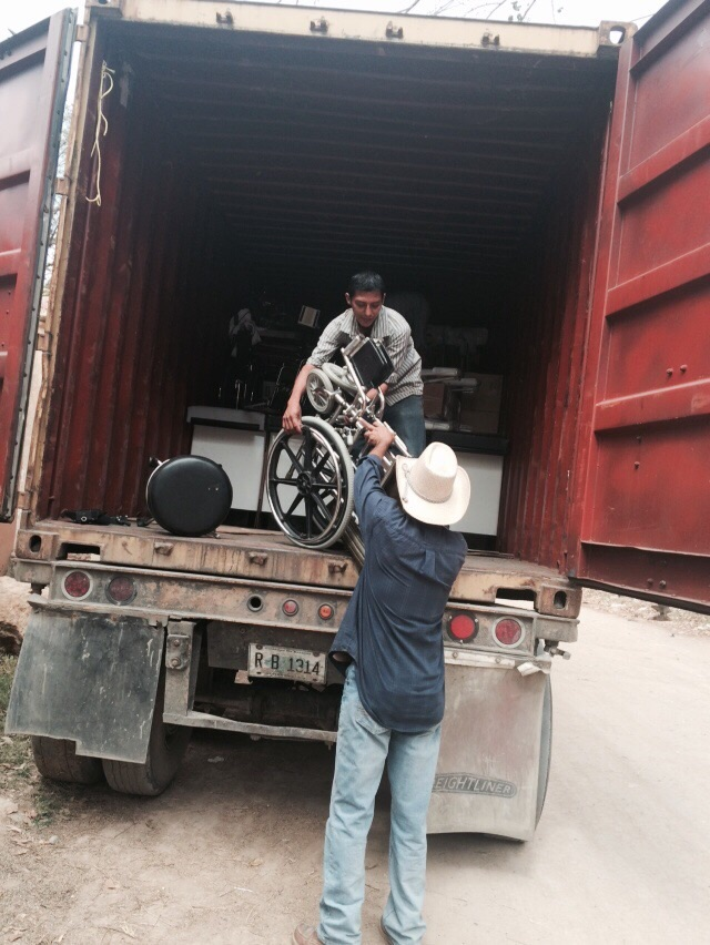 Unloading a donated wheel chair