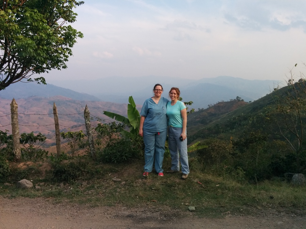 Heather and Chloe, Pediatric Residents, stopping for a picture with the breathtaking Honduran scenery after a day's work.