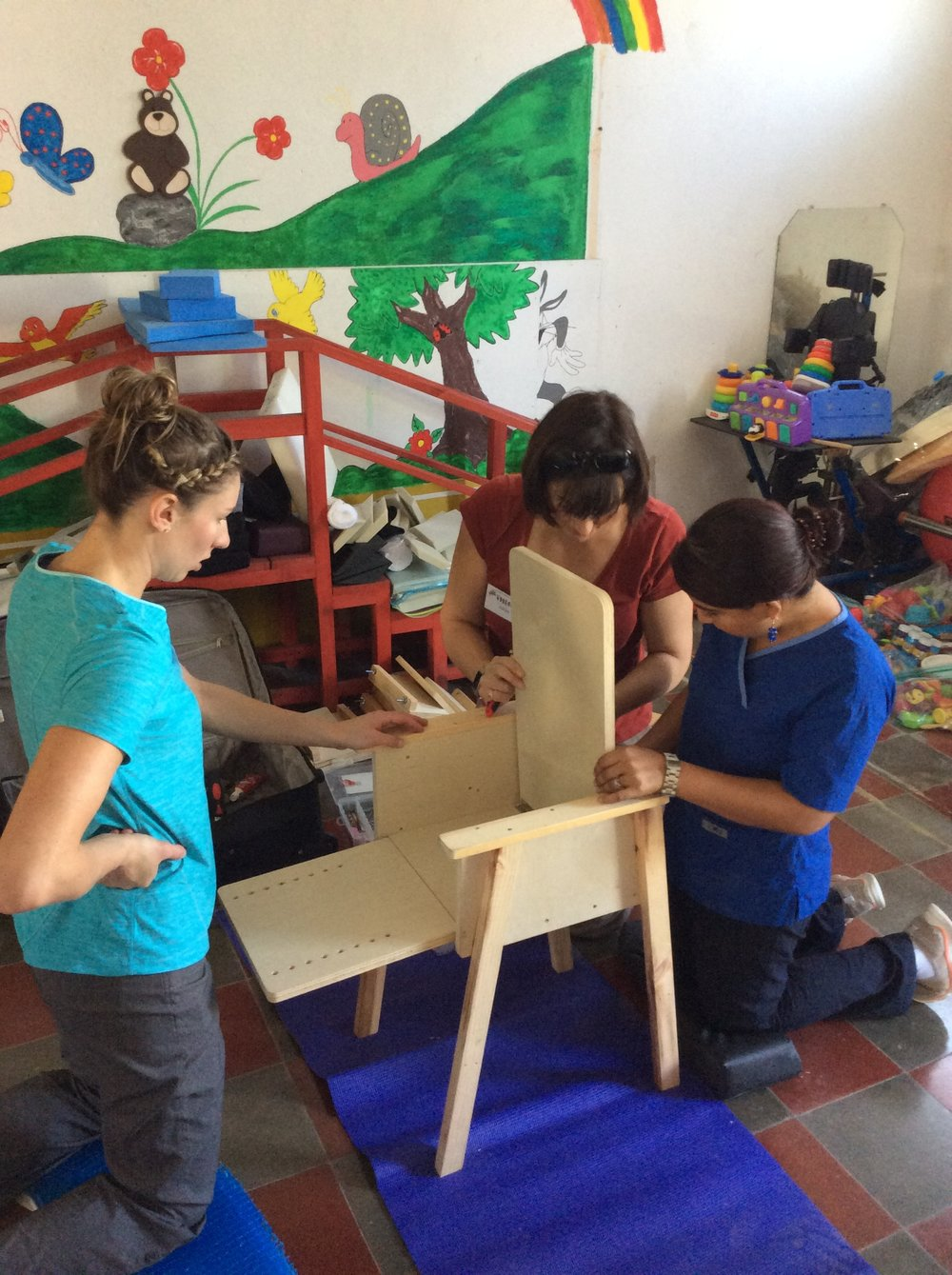 Our team is hard at work constructing one of our magic chairs for a little patient. The chairs were a big hit with so many families who don't have kid-size chairs to give their children the support they need to sit and participate in daily activities.
