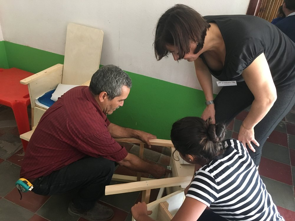 Ovidio, the carpenter, works with Ashley and one of our translators to measure and make a plan to make more chairs.