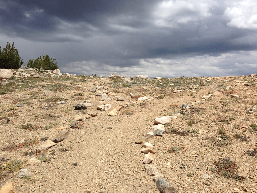 Day2 Kennedy Pass foreboding sky rock lined trail SeKi July14.JPG