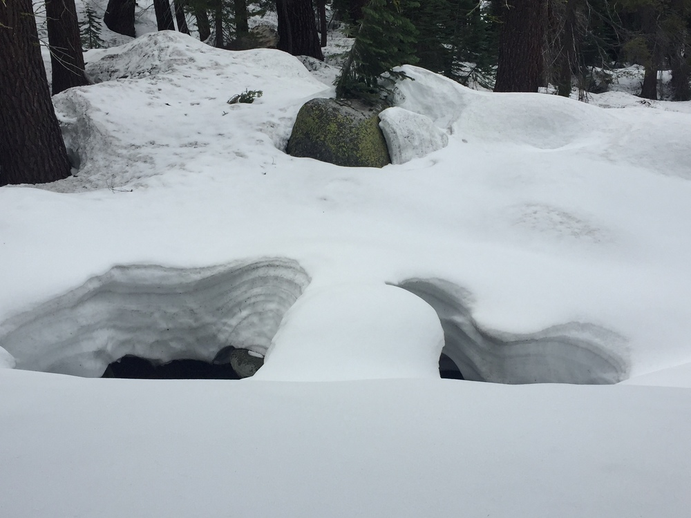 Deep snow pits along Snow Creek