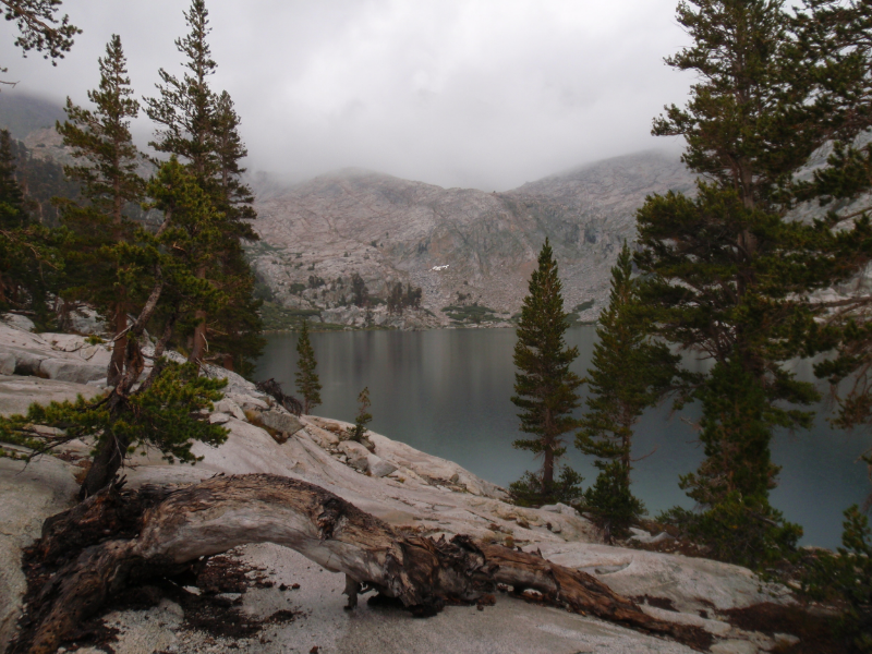 Colby Lake in early evening with clouds obscuring the pass