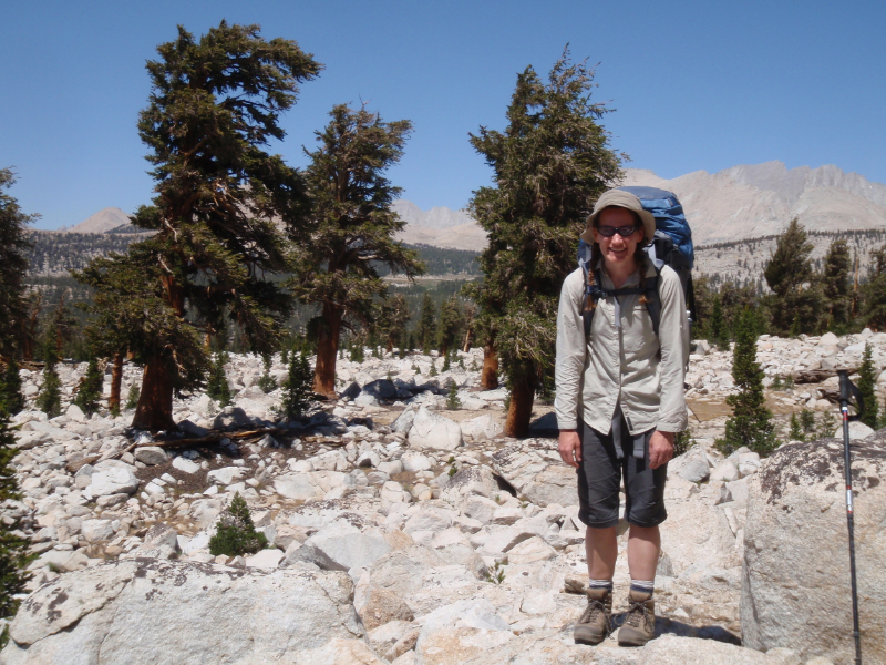 Cheri tries not to melt in the day's heat on the JMT above Wallace Creek surrounded by foxtail pine
