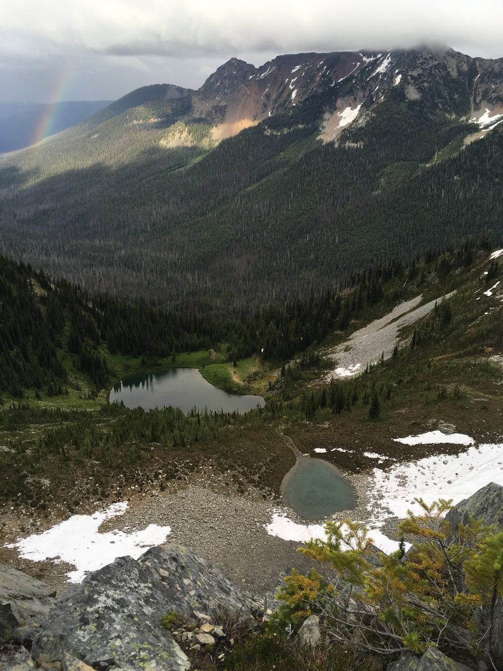 Late evening rainbow, storms and alpine lakes.