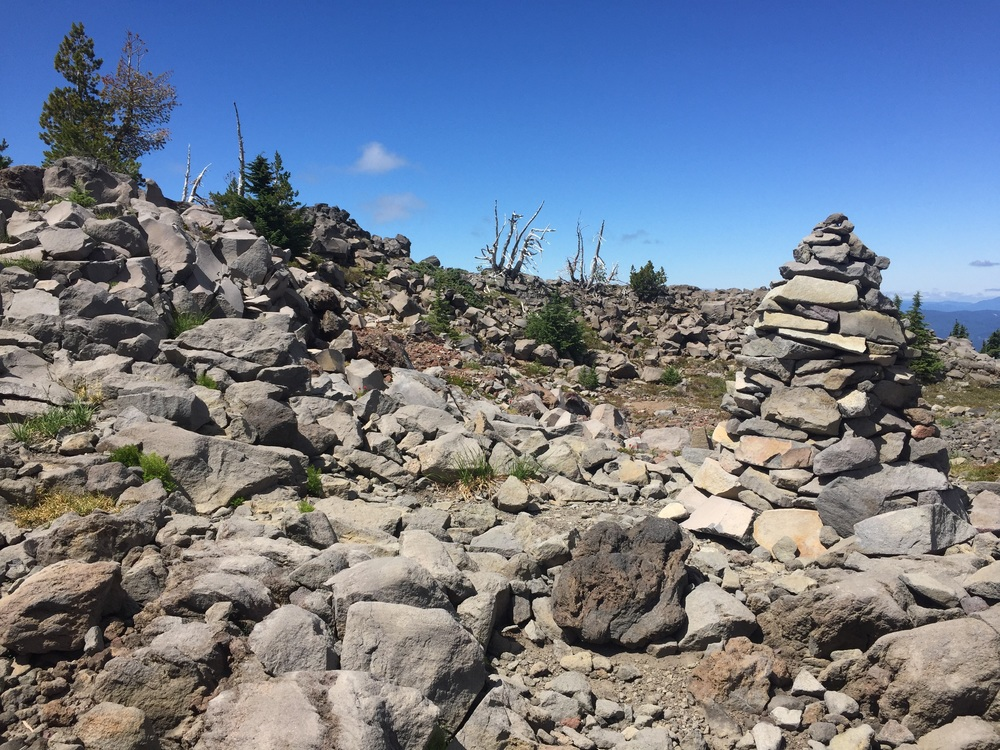 Vegetation gives way to huge rock cairns as we near the top of our climb
