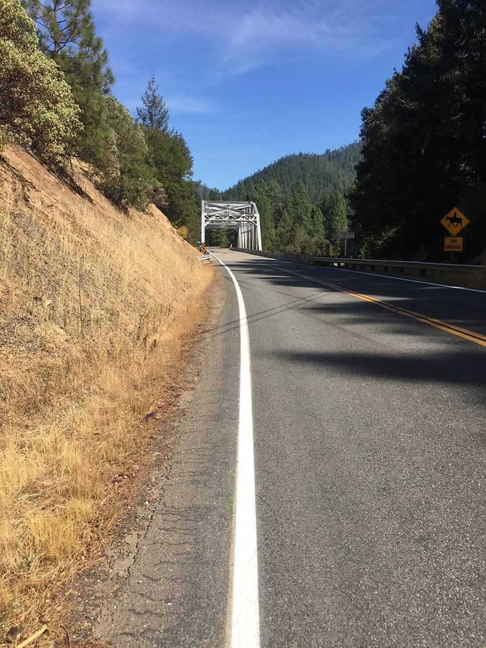 Road-walk on Hwy 96 towards the Klamath River bridge on a hot August day