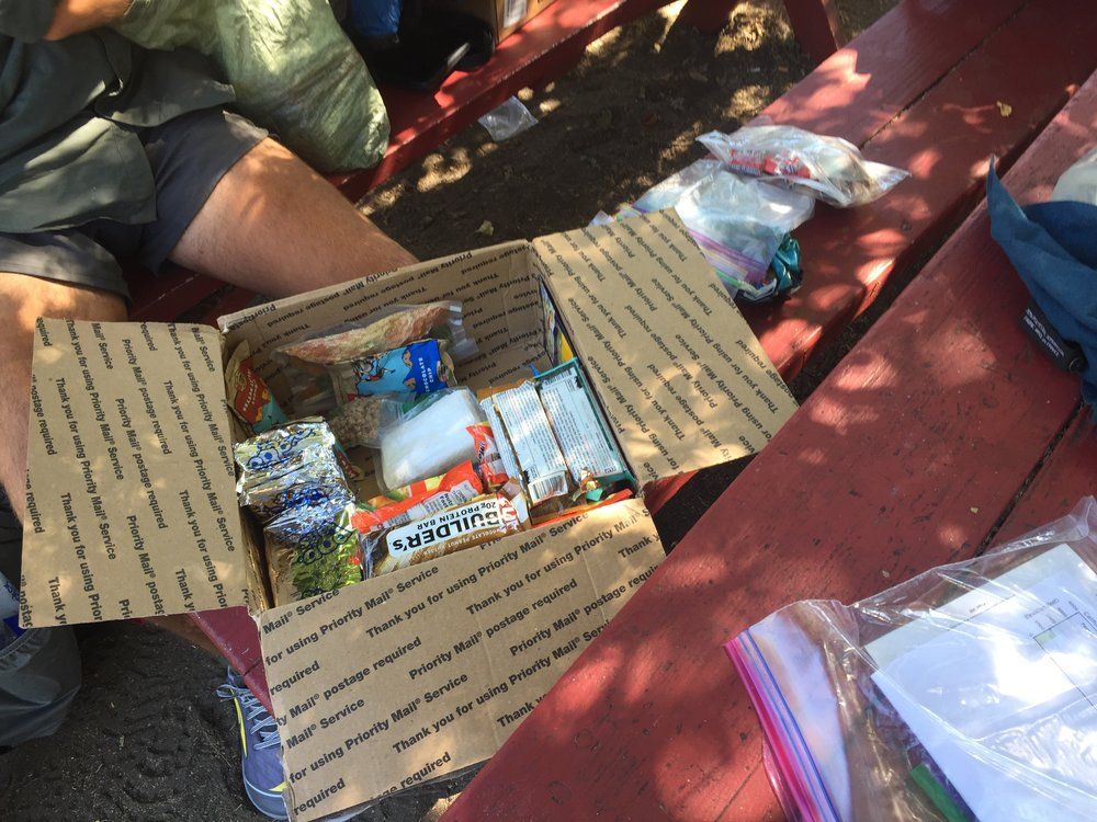 "Neeemor's 6-day resupply to Mt Shasta City fit entirely in this box. Pop tarts for breakfast, Clif & Builders bars for lunch, and ramen for dinner. Oh, and a ziploc of cookie bars with an ""I love you"" note. No wonder his backpack is so tiny!"