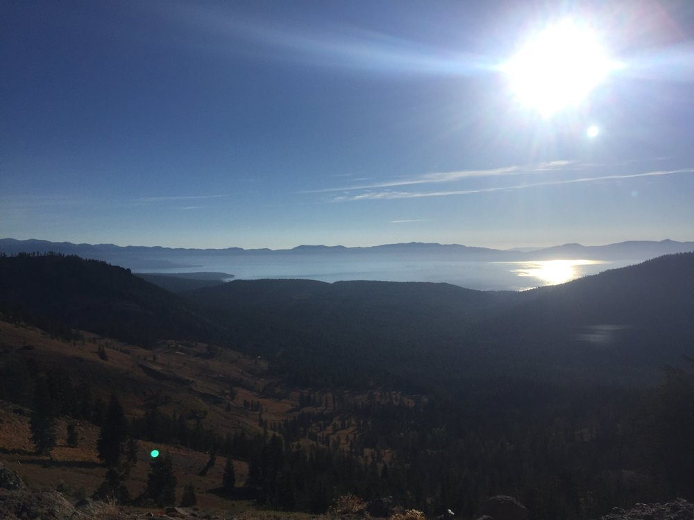 Lake Tahoe glitters in the morning sunlight from our high ridgeline vantage point