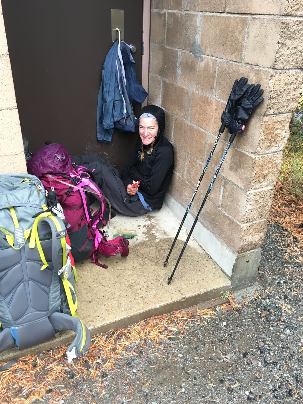 The outhouse alcove made a perfect place to stay dry and eat a snack before Vicki arrived to pick us up at Sonora Pass in the storm. (You know you're a thru-hiker when...)