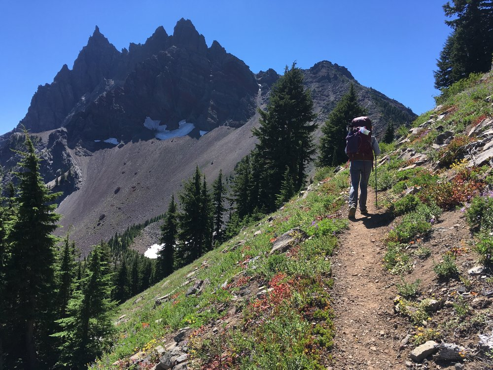 PCT Day 36- C on the climb to west shoulder of Three Fingered Jack.JPG