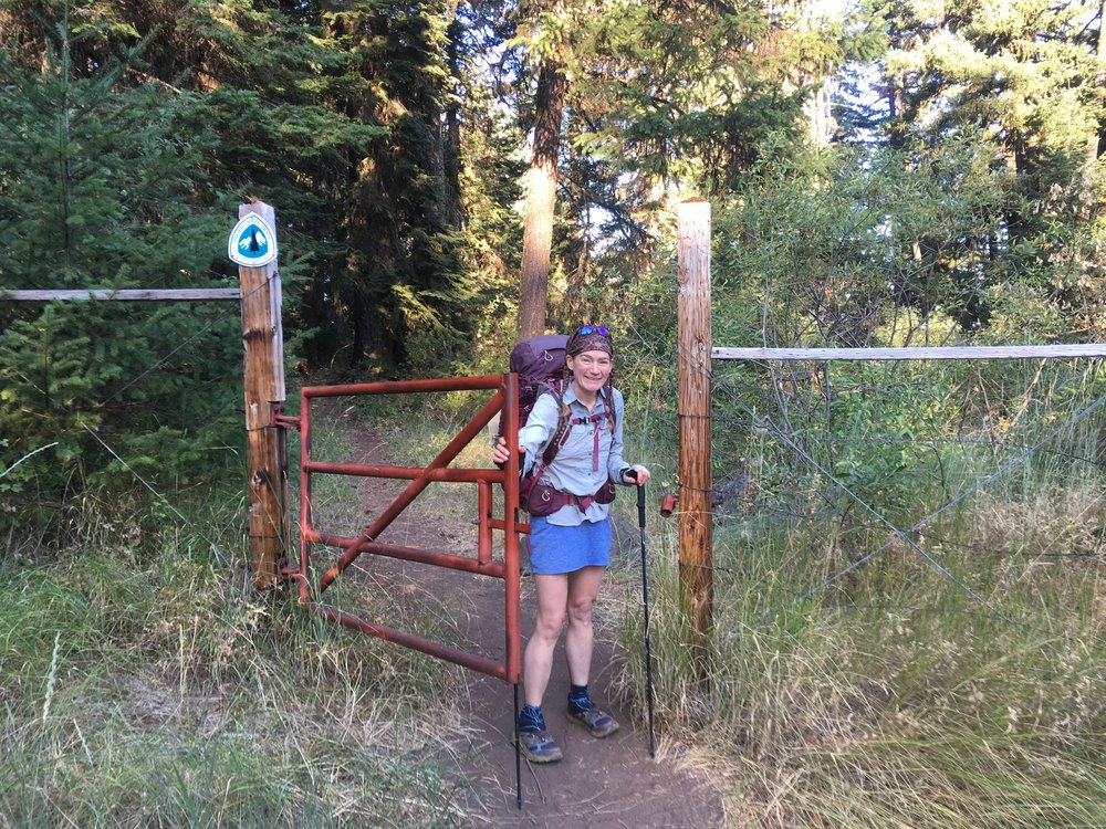 PCT Day 47- C and the pipe gate near Ashland.JPG
