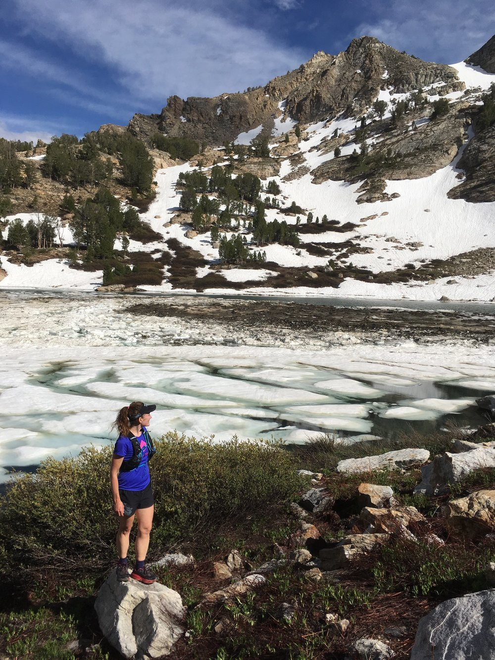 Cheri gazing at Liberty Pass across a rather icy Lamoille Lake