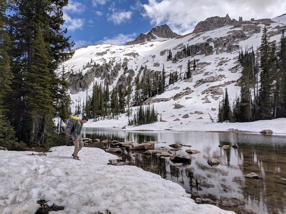 """Andrew looking for a place to cross the outlet of """"Snowyside Lakes"""" - the weather made a 180 in the past half-hour."""