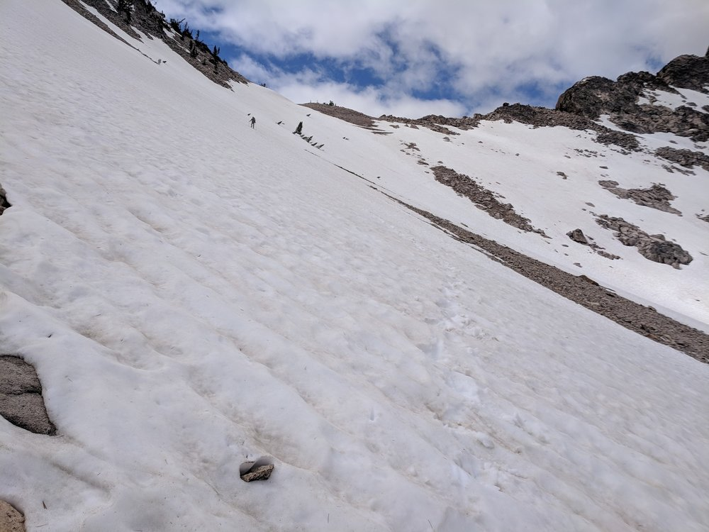 Andrew making his way down a steeper, longer snowfield