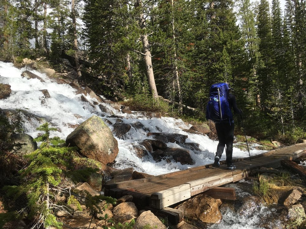 Early season high water coming out of Imogene Lake