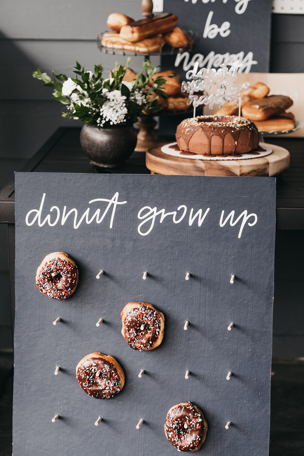 Donut party, doughnut party, first birthday party ideas, doughnut jokes, donut phrases, donut sign, doughnut sign, doughnut birthday ideas, donut birthday ideas, first birthday ideas, boys birthday party, 100 layer cake party, boys first birthday ideas, doughnut pegboard, donut pegboard, donut display wall, doughnut display wall, chic boys party, painted playhouse, white playhouse, playhouse makeover, outdoor play house makeover